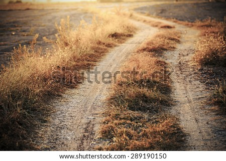 vintage photo of country road in sunset  - stock photo