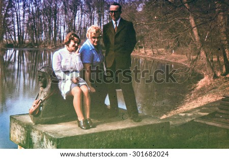 Vintage photo of couple with teenager daughter (early 1970's) - stock photo