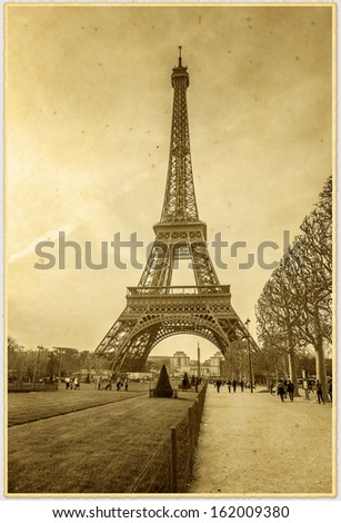 Vintage photo of Eiffel Tower (See original photo ID: 124171525). Eiffel Tower located on Champ de Mars in Paris is tallest structure in Paris and most visited monument in the world. France. - stock photo