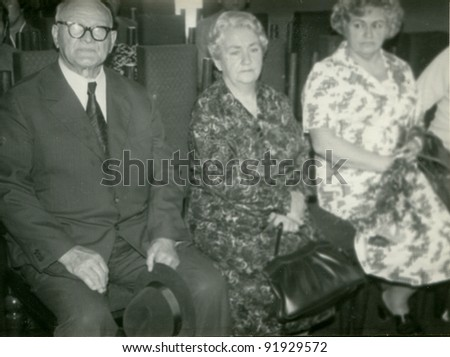 Vintage photo of elderly couple and adult daughter (sixties) - stock photo