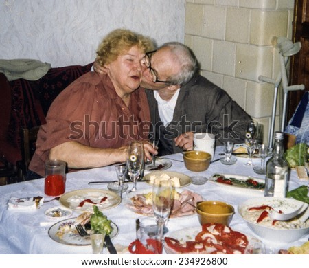Vintage photo of elderly couple's wedding anniversary, eighties - stock photo