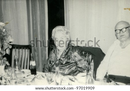 Vintage photo of elderly couple (seventies) - stock photo