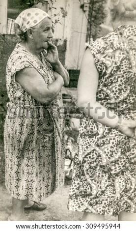Vintage photo of elderly farmer woman, 1950's - stock photo