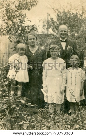 Vintage photo of family (early thirties) - stock photo