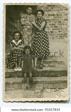 Vintage photo of family (fifties) - stock photo