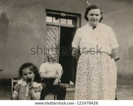 Vintage photo of family (grand father, mother and daughter) - fifties - stock photo