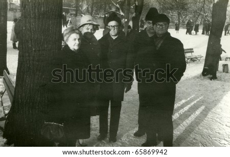 Vintage photo of family in park (sixties) - stock photo