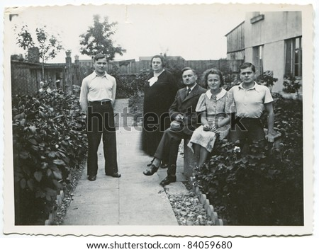 Vintage photo of family in the garden (thirties)