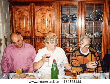Vintage photo of family members parting, eighties - stock photo