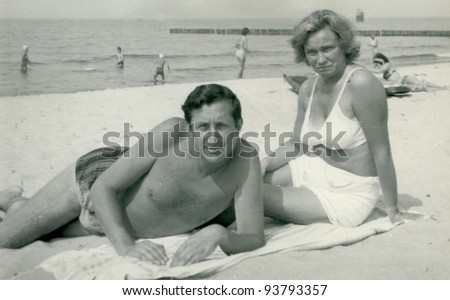 Vintage photo of family on beach (sixties) - stock photo