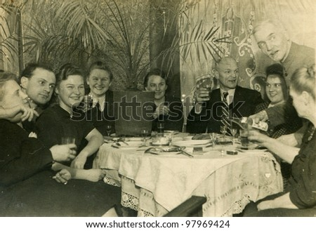 Vintage photo of family parting (fifties) - stock photo