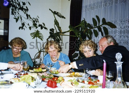 Vintage photo of family party - early nineties - stock photo