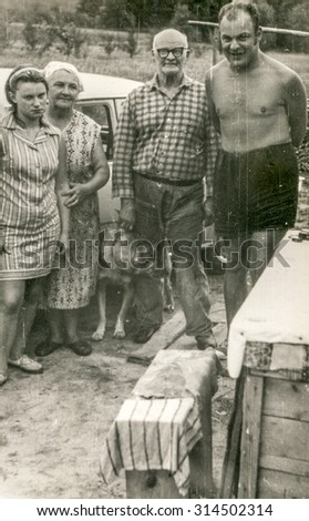 Vintage photo of farmers family outdoor, 1950's - stock photo