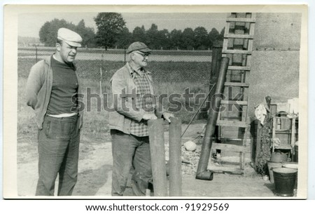 Vintage photo of farmers (fifties)