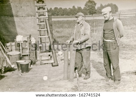 Vintage photo of farmers working, fifties - stock photo