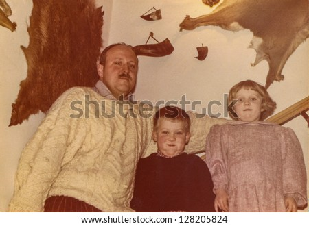 Vintage photo of father with children, early eighties - stock photo