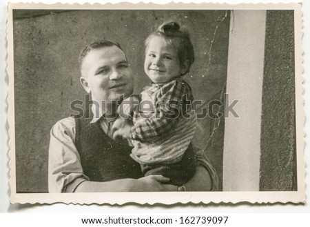 Vintage photo of father with daughter, fifties