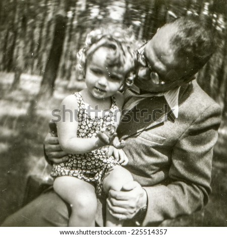 Vintage photo of father with little daughter, fifties