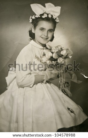 Vintage photo of First Communion (fifties) - stock photo