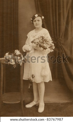Vintage photo of girl - First Communion, twenties - stock photo