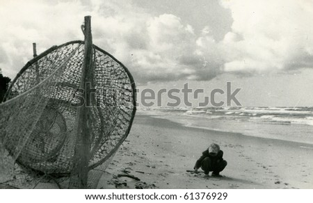 Vintage photo of girl on a beach (fifties) - stock photo