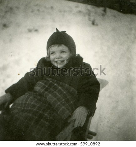 Vintage photo of girl on sled (fifties) - stock photo