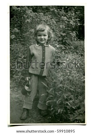 Vintage photo of girl with watering can (fifties) - stock photo