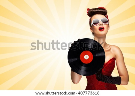 Vintage photo of glamorous pinup girl wearing long gloves and dressed in a red sexy corset, holding LP vinyl record on colorful abstract cartoon style background. - stock photo