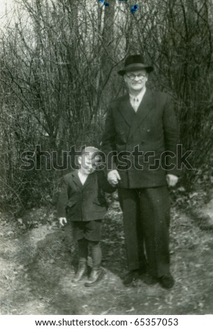 Vintage photo of grandfather and grandson (fifties) - stock photo