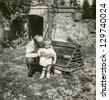 Vintage photo of grandfather and little grandson outdoor (forties) - stock photo