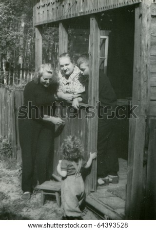 Vintage photo of grandmother, mother and her children (fifties) - stock photo