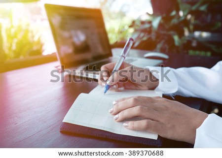 Vintage photo of Handwriting, hand writes a pen in a notebook,soft focus. - stock photo