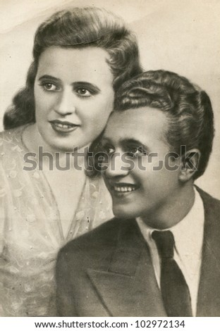 Vintage photo of happy couple (forties) - stock photo