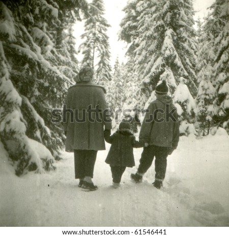 Vintage photo of happy family in winter setting (fifties) - stock photo
