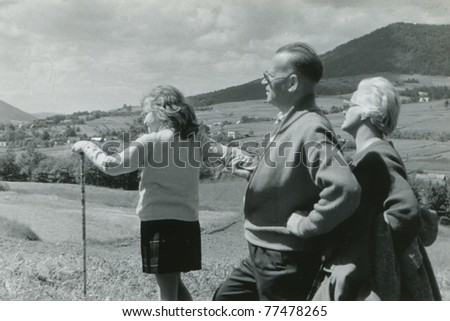 Vintage photo of happy family walking in mountains (early sixties)