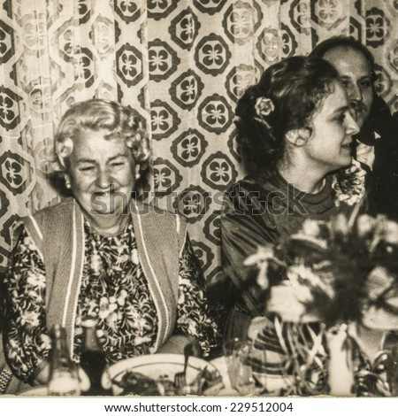 Vintage photo of happy grandmother during her grandson wedding party, 1979 - stock photo