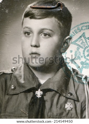 Vintage photo of little boy in scout uniform (fifties) - stock photo