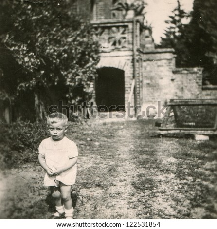 Vintage photo of little boy outdoor, forties