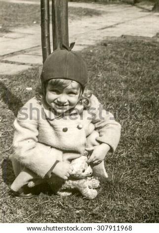 Vintage photo of little girl, circa 1958 - stock photo