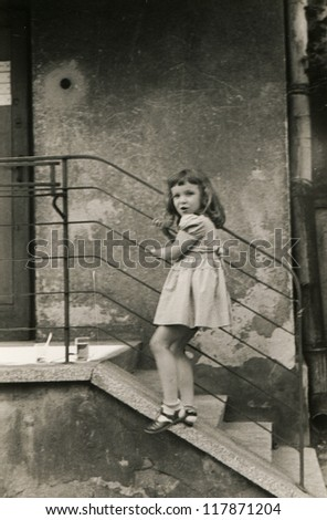 Vintage photo of little girl (fifties) - stock photo