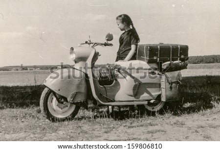 Vintage photo of little girl with a scooter (fifties) - stock photo