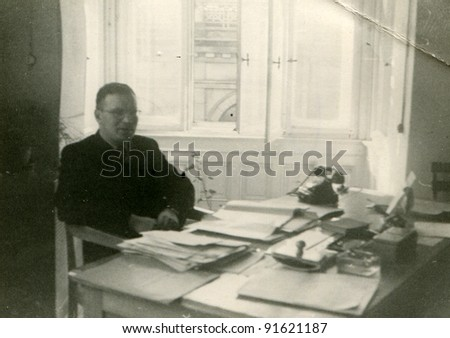 Vintage photo of man in an office (fifties)