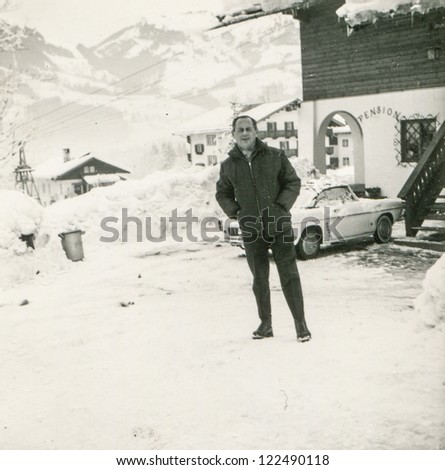 Vintage photo of man in mountain ski resort (fifties) - stock photo