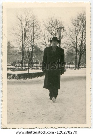 Vintage photo of man in winter (fifties) - stock photo