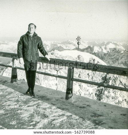 Vintage photo of man in winter, fifties - stock photo