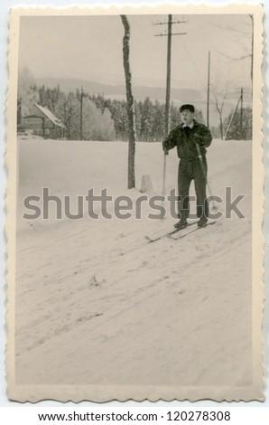 Vintage photo of man skiing (fifties) - stock photo