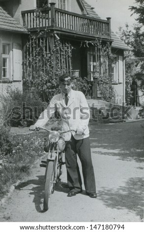 Vintage photo of man with a motorbike, 1946 - stock photo