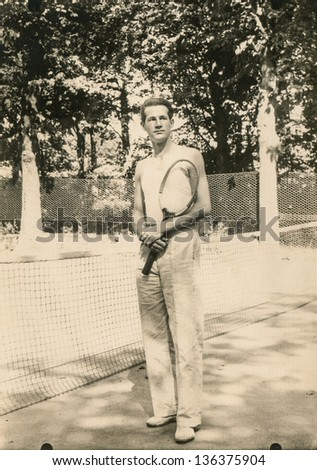 Vintage photo of man with tennis racket, forties - stock photo