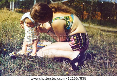 Vintage photo of mother and daughter (1981) - stock photo