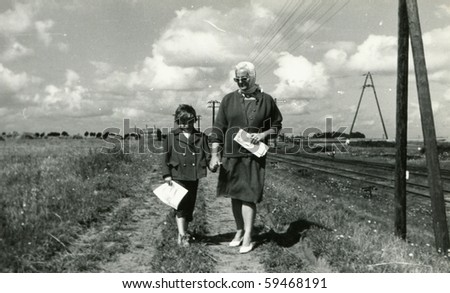 Vintage photo of mother and daughter (circa 1960) - stock photo